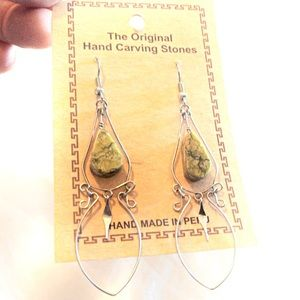 Dangle earrings with hand carved stones